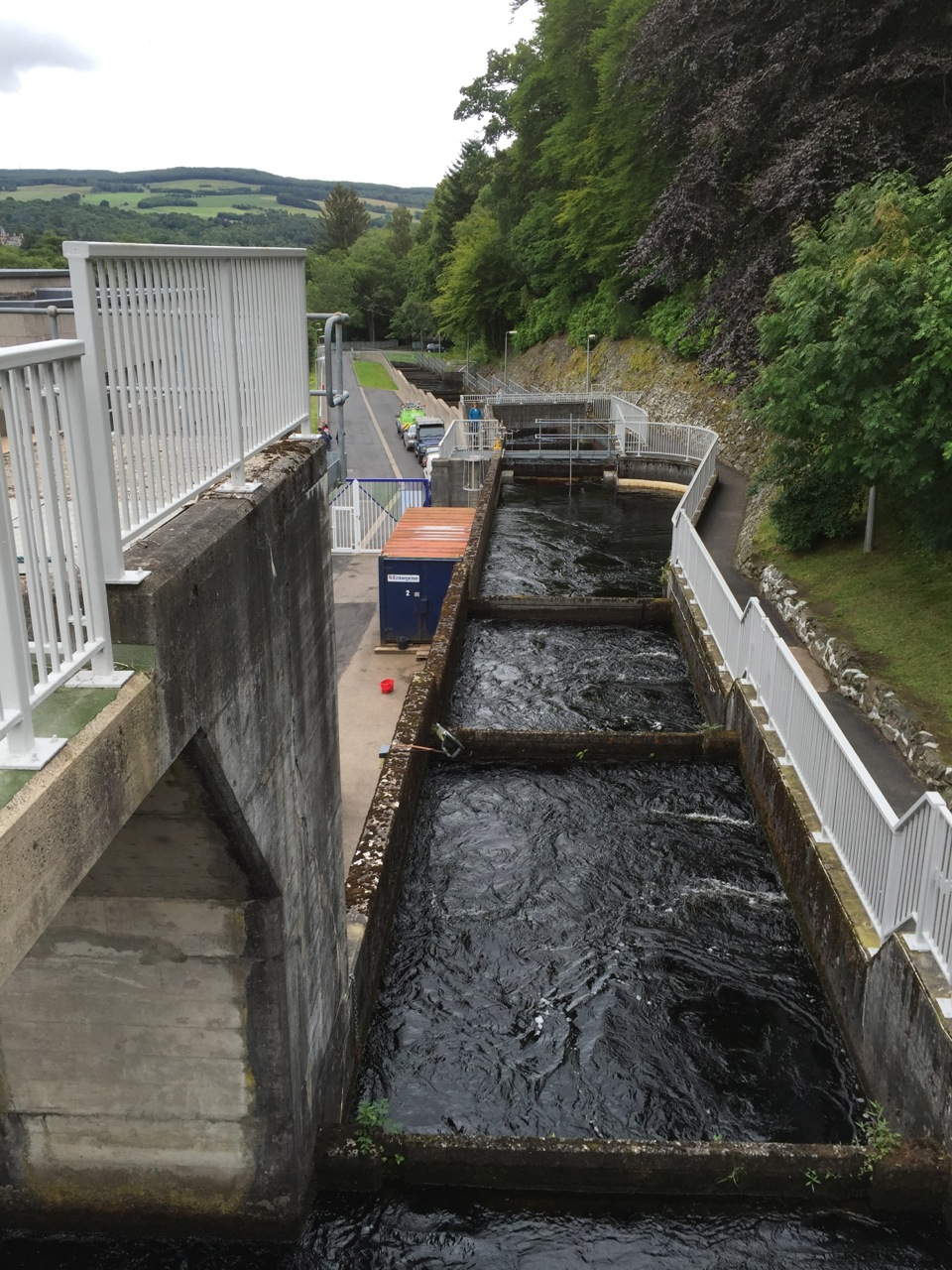 The fish ladder at the hydropower plant at Pitlochry, Scotland. More than 3,000 salmon had used the ladder (a series of lochs of different levels) to bypass the dam this season. Without the ladder, the fish would get sucked into the turbines and most would not survive.