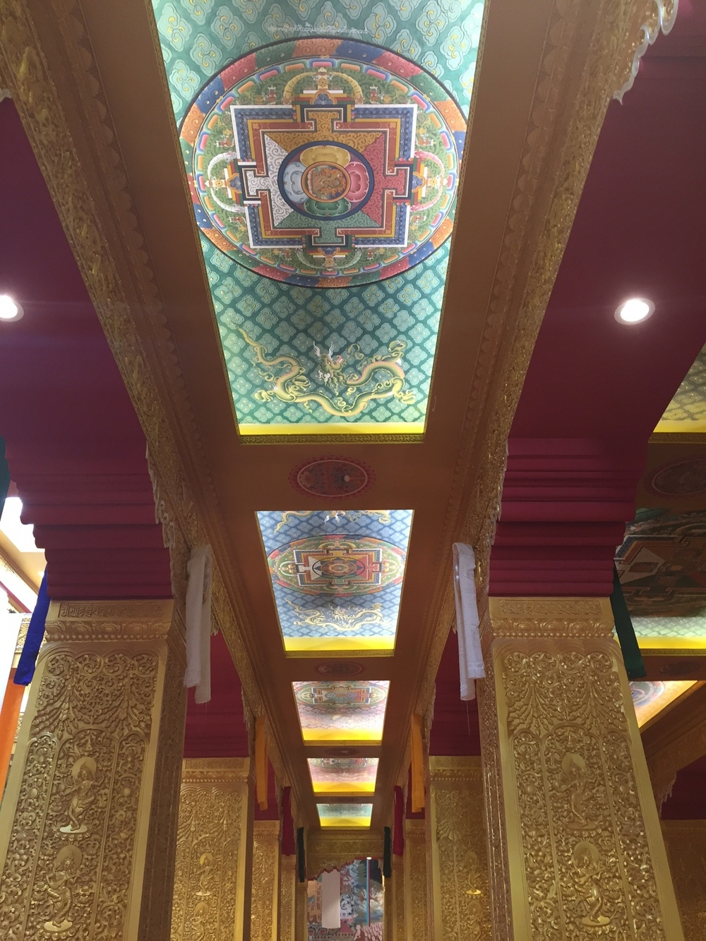Looking up at the ceiling of the Buddhist temple supporting this gigantic Buddha statue.