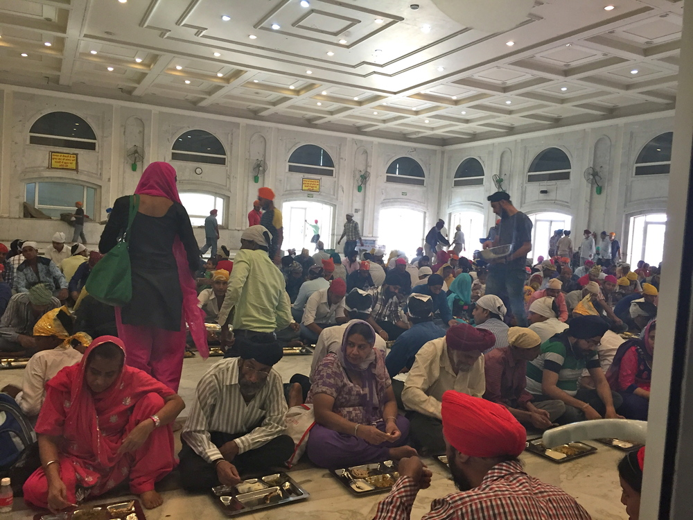 Thousands of people from any faith or creed eat free every day at this Sikh temple in Delhi.