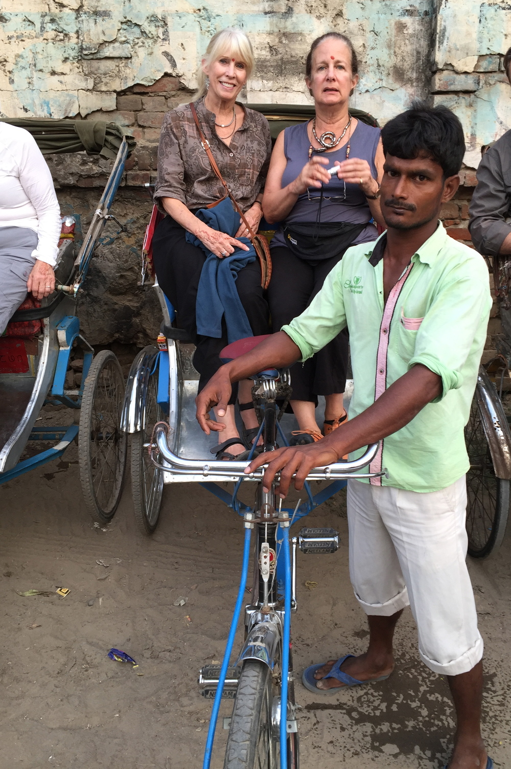 I'm seated with my friend Nina in a bicycle rickshaw, getting ready to travel through Old Varanasi to the Ganges boat launch. The return trip would be hair-raising...