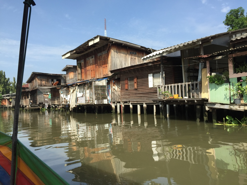 Cruising the canals of Bangkok through a fascinating neighborhood of houses built on the water.