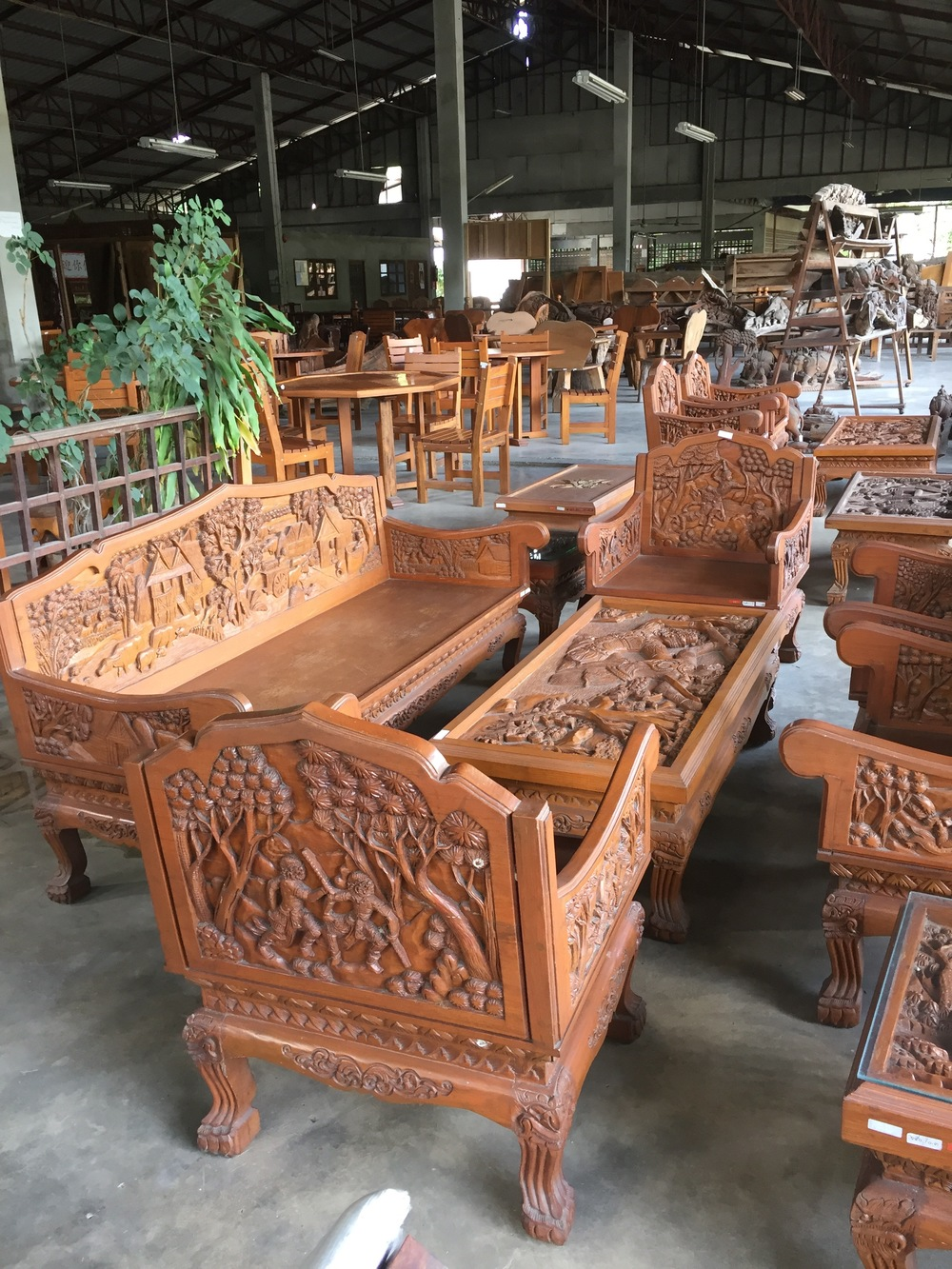 Teak warehouse in Chang Mai where you can buy big, ornate furniture made from teak at discount rates. US tourists are the biggest consumers, according to warehouse personnel.