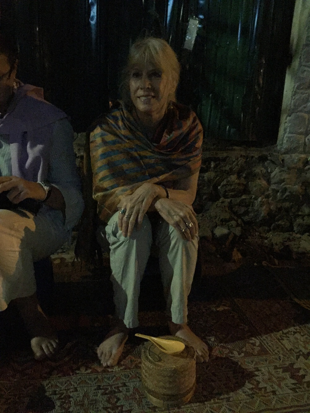 Me waiting at 5:30 a.m. along the main street in Luang Prabang, Laos to make a rice offering to the daily procession of Buddhist monks with their begging bowls.