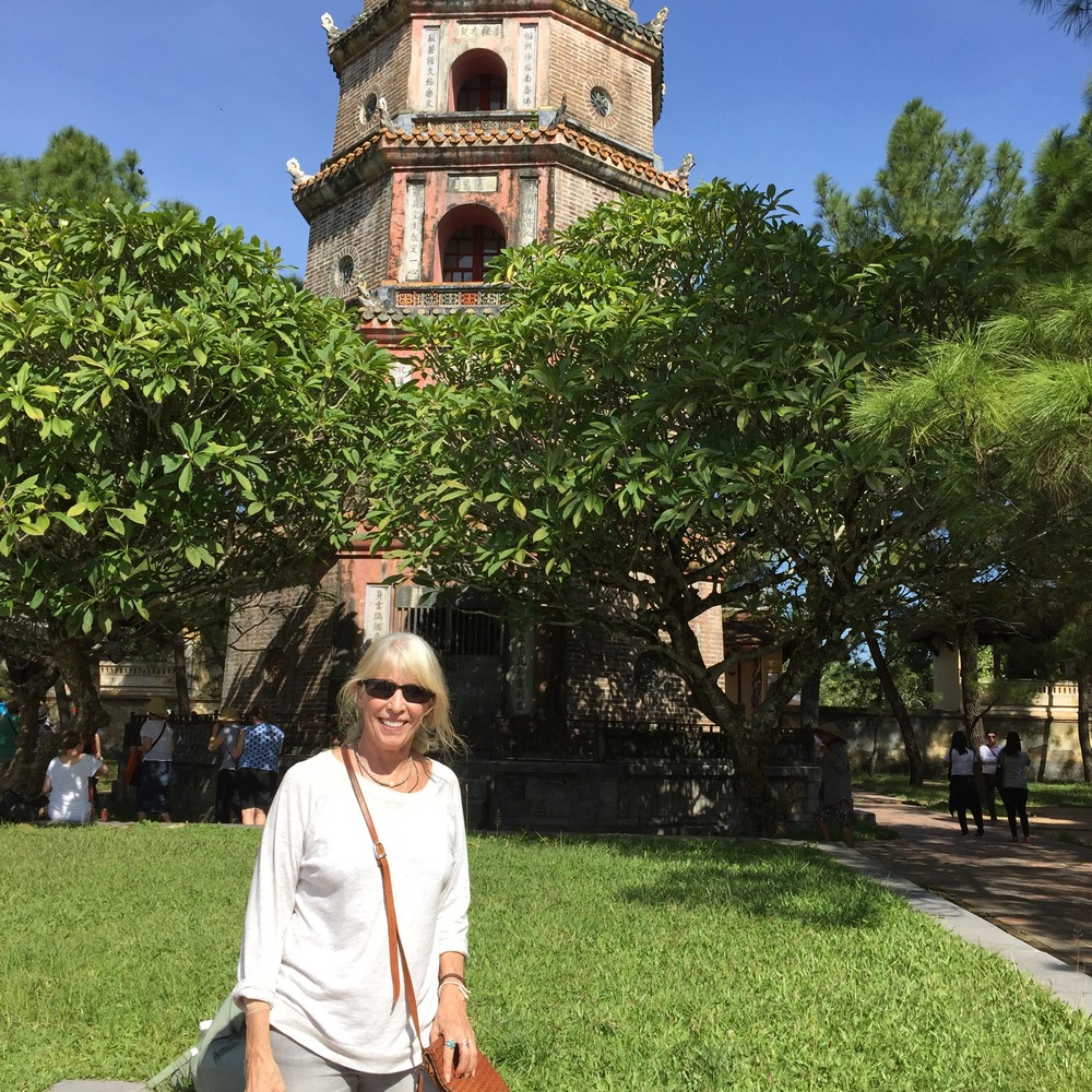 This is me standing in front of the city of Hue's famous Thien Mu Pagoda. The pagoda lies within an active Buddhist monastery that was built in 1601.