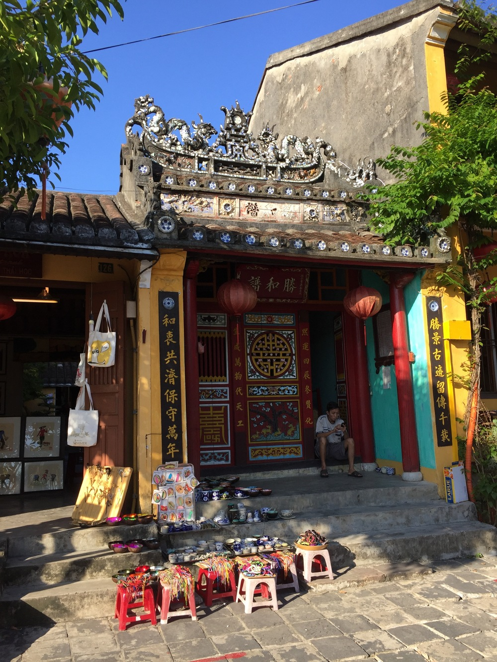 The picturesque city of Hoi An is a thriving tourist destination, full of shops that oddly all contain the same inventory of merchandise for sale.