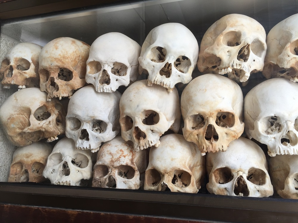 On display behind glass are some of the 8,000 skulls of victims executed by the Khmer Rouge at the Killing Fields outside of Phnom Pehn.
