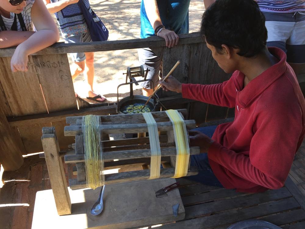 Spinning silk thread from silk worm cocoons at Santuk Silk Farm on the way from Phnom Penh to Angkor Wat.