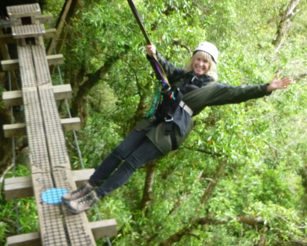Me perched on the edge of a swinging bridge in the Dansey forest canopy. (Photo 2016, courtesy of Rotorua Canopy Tours)