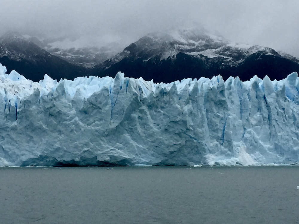 The face of Argentina's Perito Moreno Glacier is as tall as a 20-story building. In the background are the Andes and in the foreground is Lake Argentina.