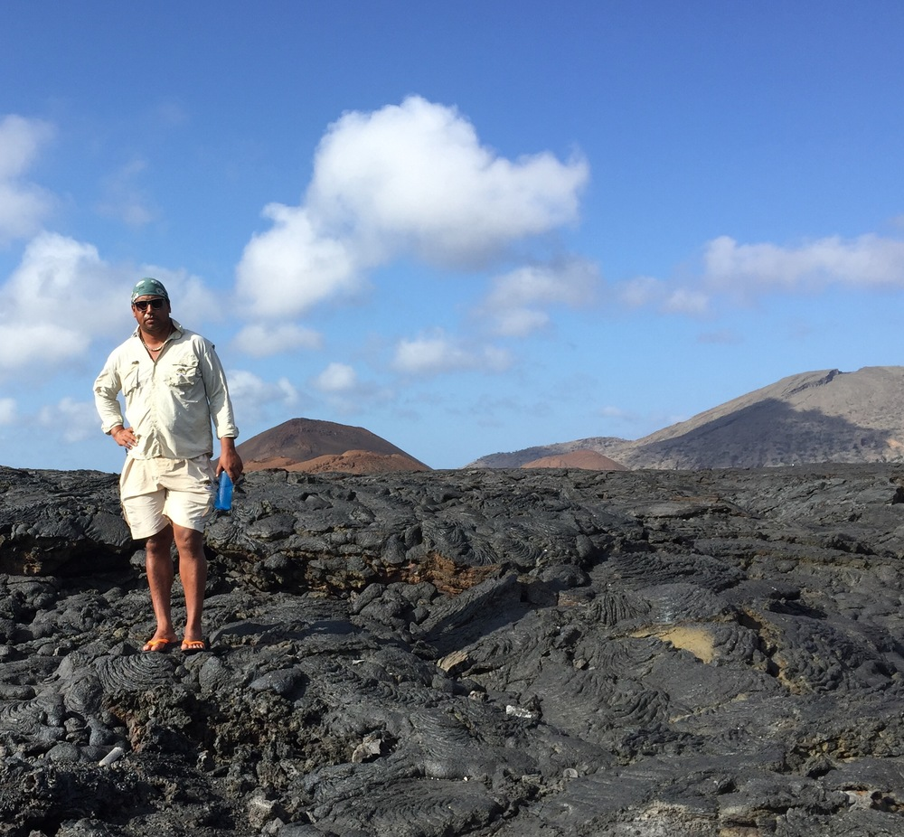 Our guide Wilo standing on a lava formation of Santiago Island