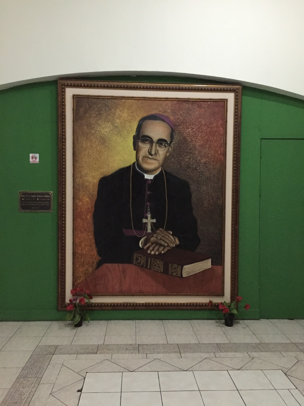 A painting of Archbishop Oscar Romero in San Salvador Cathedral at San Salvador Cathedral. Archbishop Romero outspokenly opposed social injustice, assassinations and torture, which were being practiced by an El Salvadoran military junta that took power in 1979. He urged the US government to stop sending aid to the junta.  He was assassinated in 1980. Shortly afterward, the Salvadoran Civil War ensued.