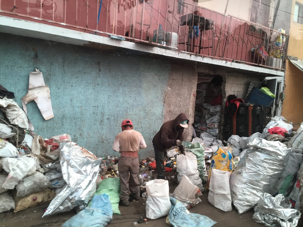 Men bagging recycables scavenged from the Guatemala City Garbage Dump.