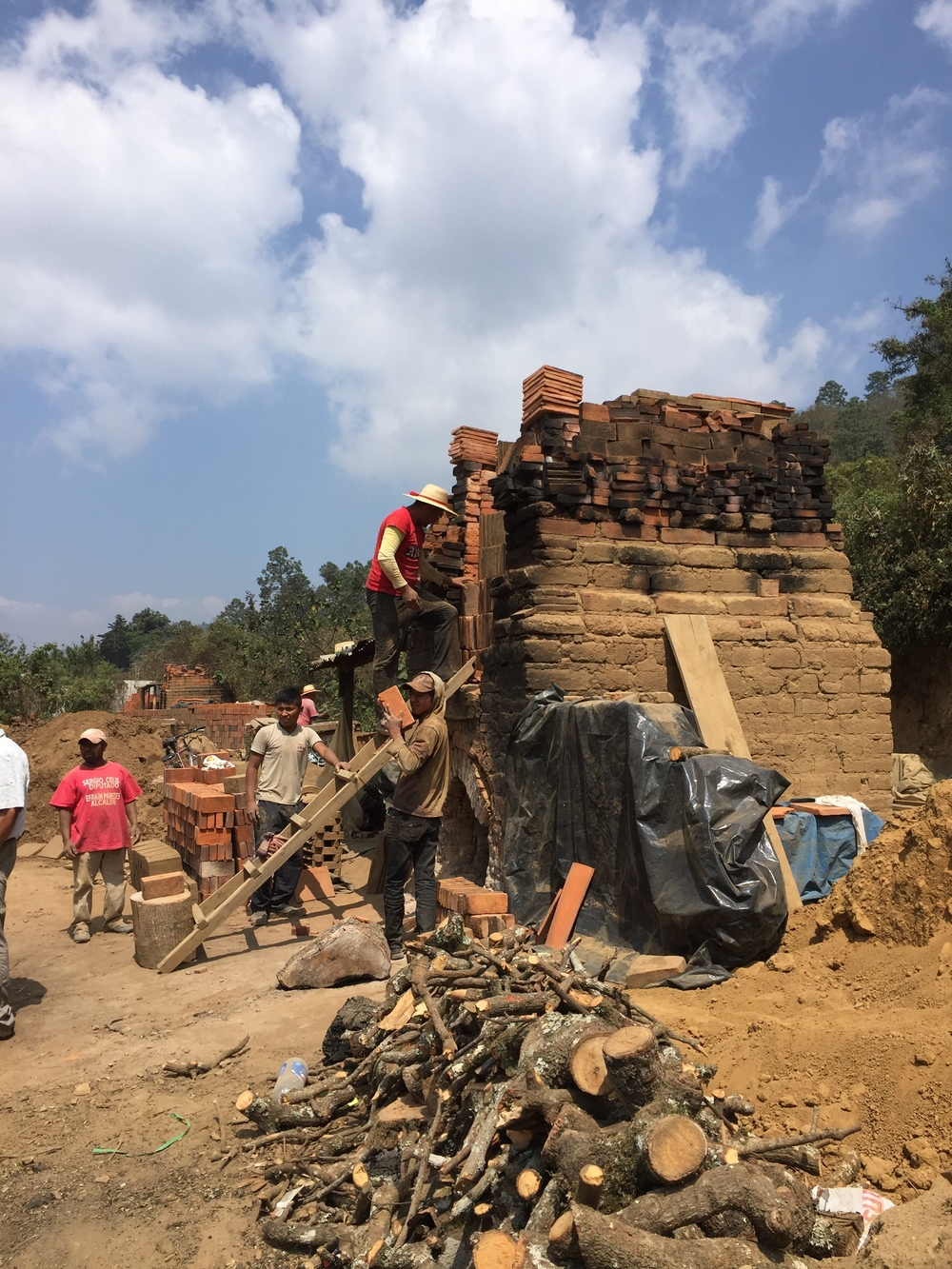 This is a small local brick-making operation along the road from Guatemala City to Panajachel known as El Tejar. The much sought-after adobe bricks are hand made and fired in small kilns.