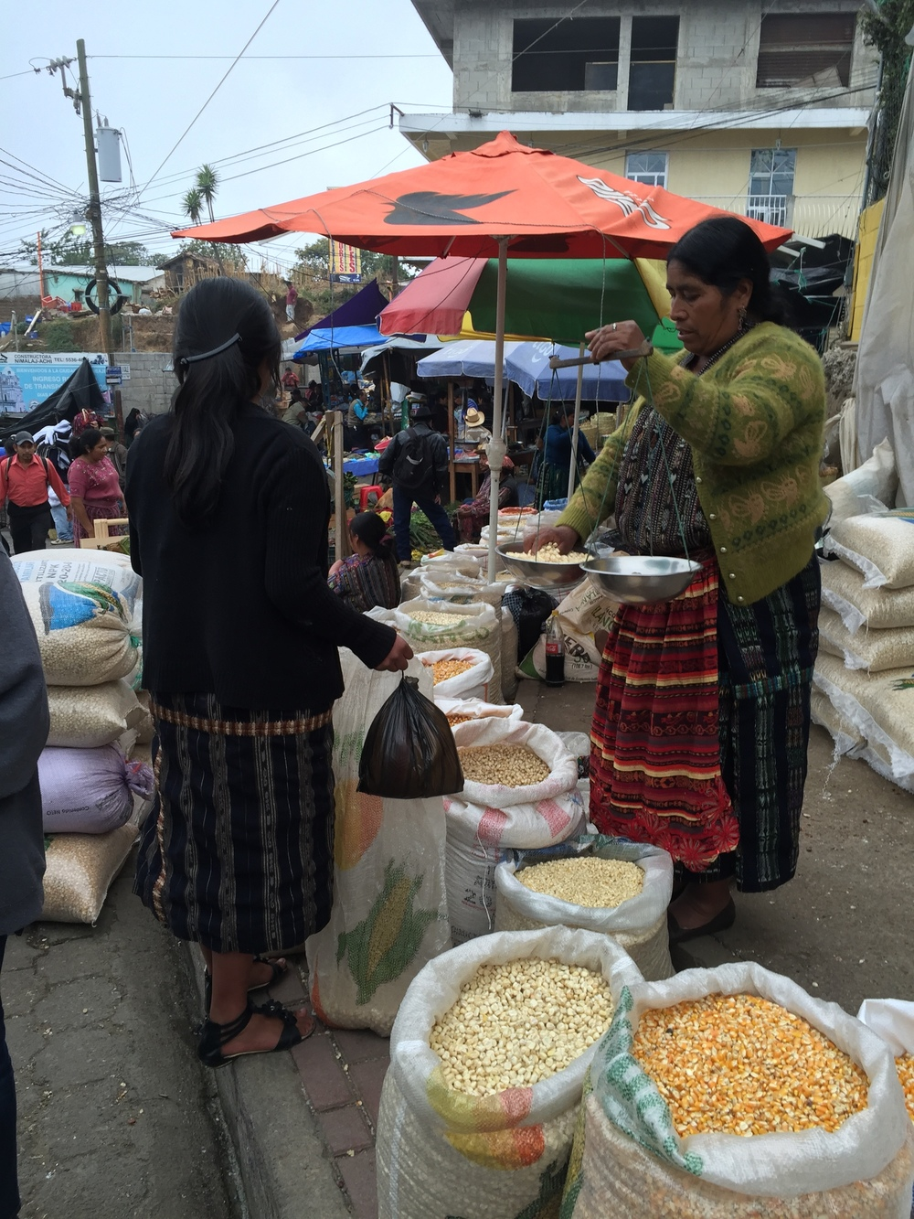 Selling maize and beans in the Solala market.