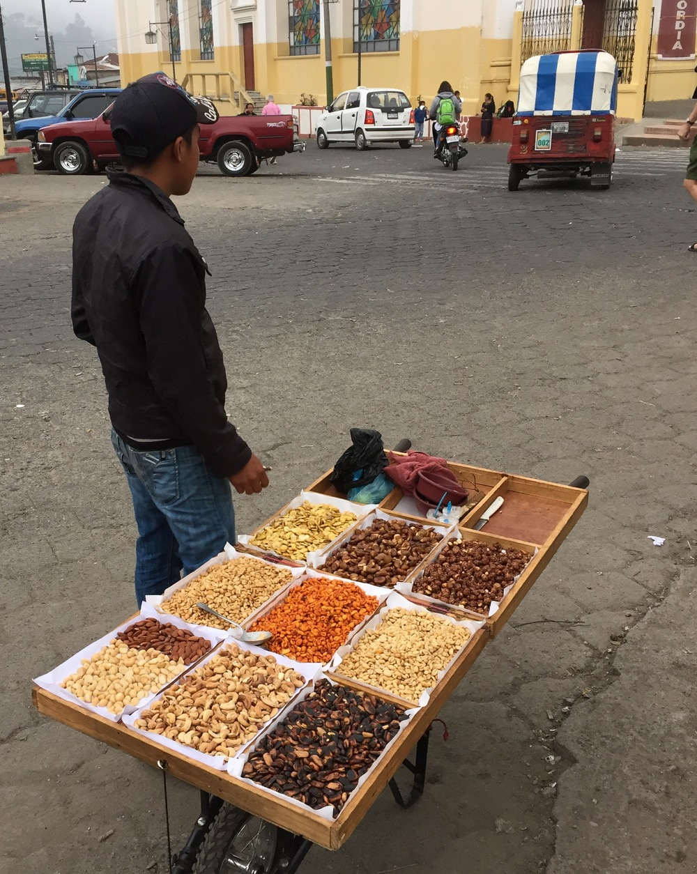 A nut vendor in the plaza outside the Solala market.