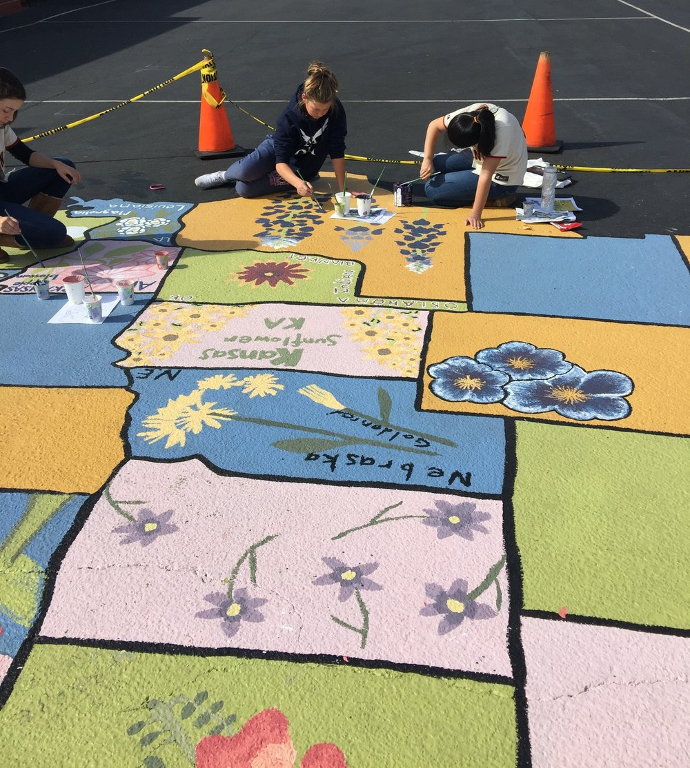 Contributed: Art teacher Sue Friedland engaged 35 young students in painting a 25-by-36 foot map of the United States in the middle of their asphalt playground at Our Lady of Angels School in Burlingame.