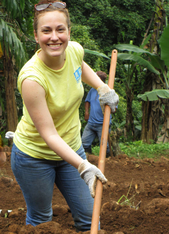 Woman gardening using sustainable farming methods