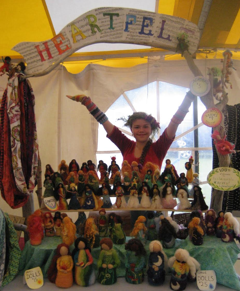Magnolia Rose presents her handmade felted dolls at the Common Ground Country Fair, in Unity, Maine