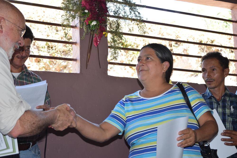 emeritus board member Jeff Clark + graduate Ernesta Madrid