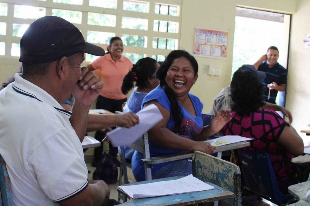Maruquel Sánchez shares a laugh with fellow participants - photo by Bailey McWilliams