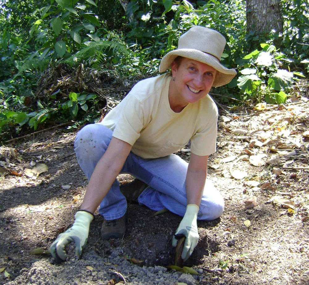 Incoming board chair Charlotte Dougherty prepares soil for planting during a 2009 trip to Piedras Negras, Honduras in 2009.