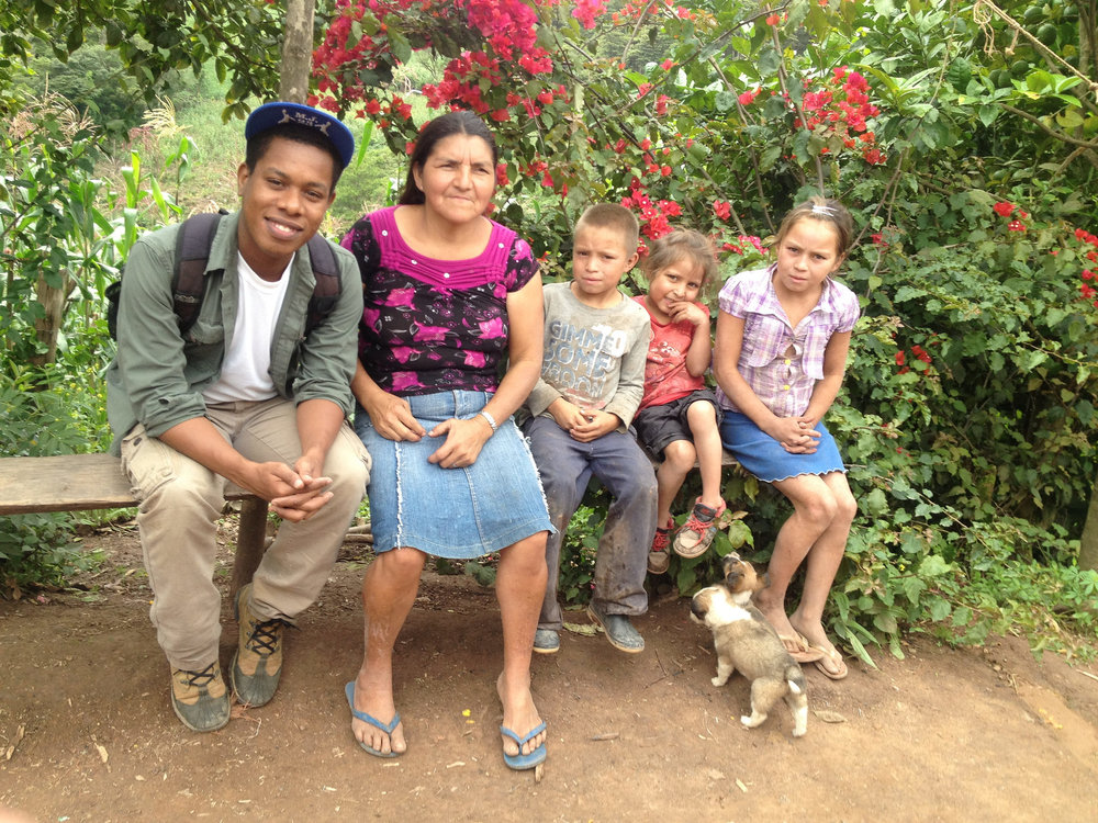 Victor met with Ererina Montolla and her children in El Pito, Honduras, and many other families, to discuss the different ways partnering with us has improved farming. - Photo by Jonatan Reyes
