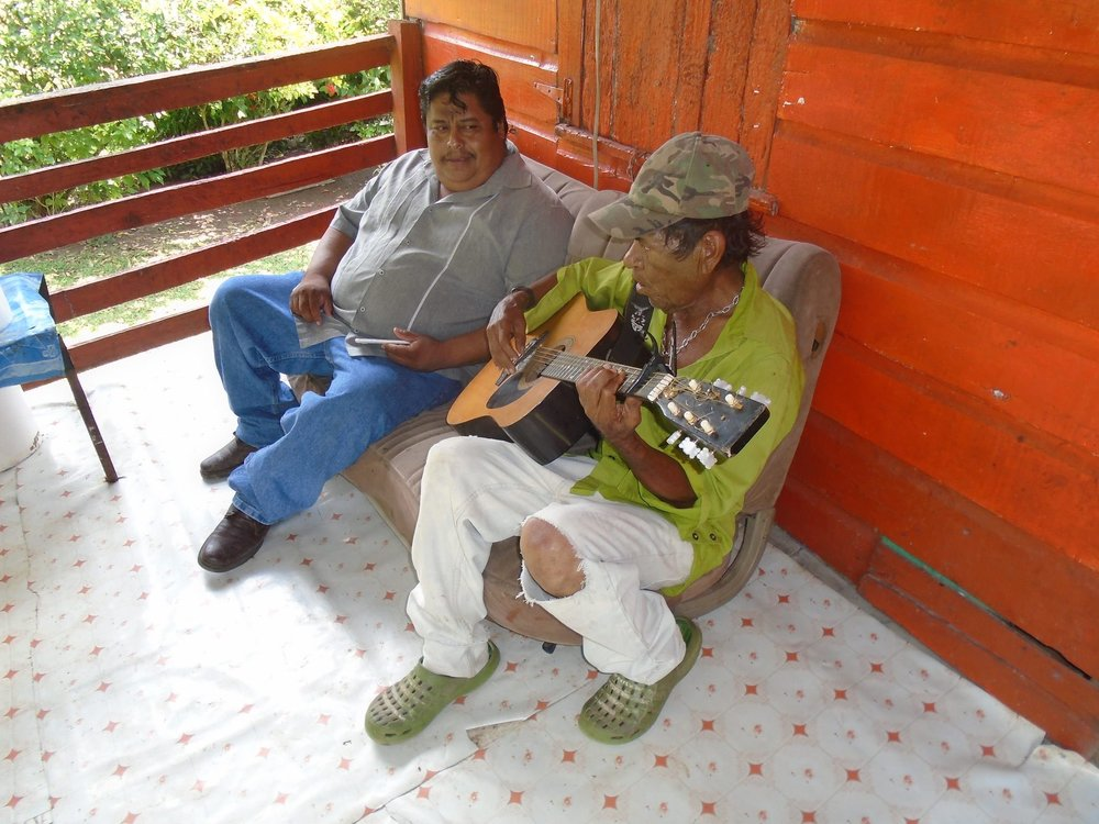 "Terence Anthony Sutherland farms with Sustainable Harvest International in the village of More Tomorrow in the Cayo District of Belize, where he's known to locals as ""Johnny Cash."" He was more than happy to give Leonardo a welcoming serenade! – Photo by Candido Chun"