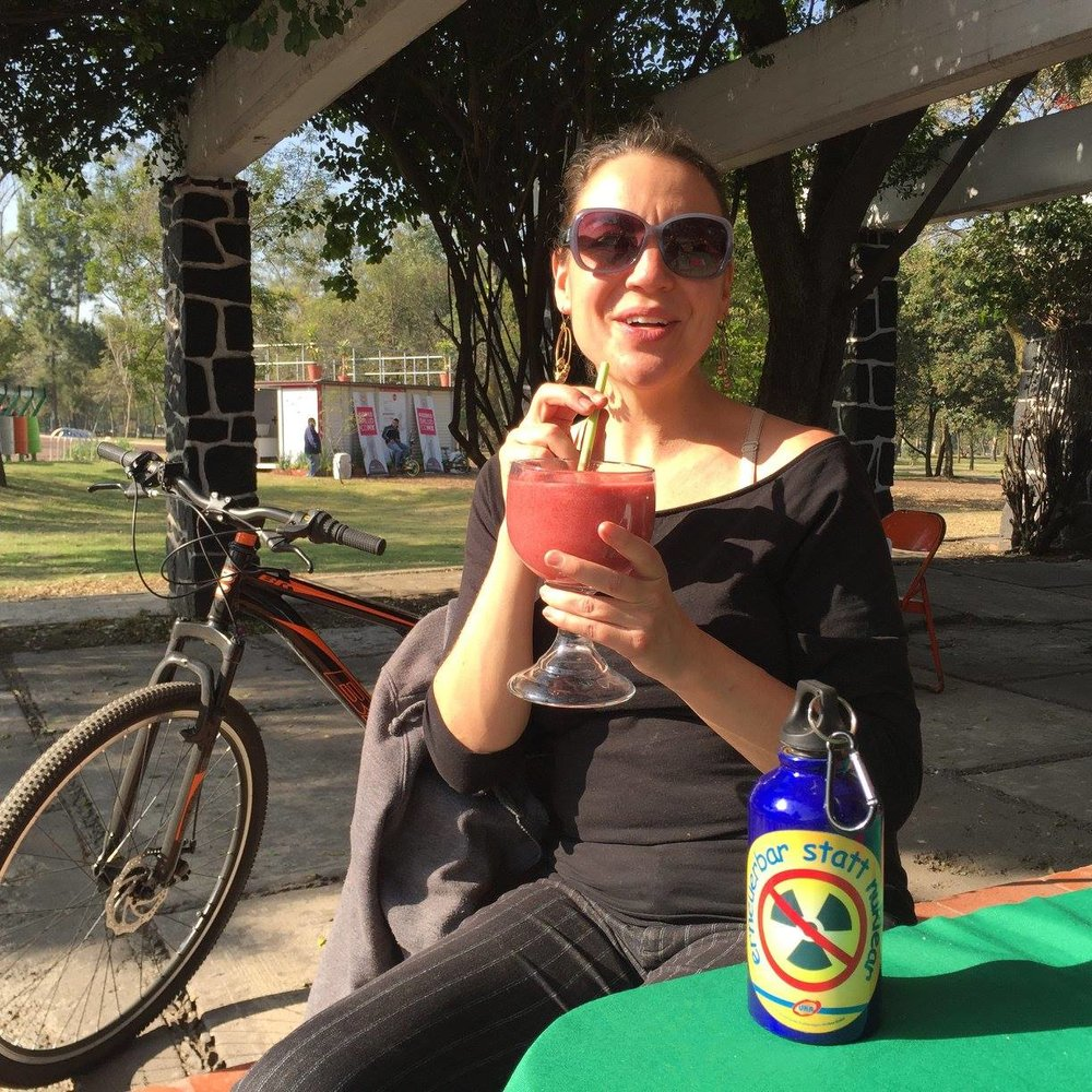 Team Captain and Board Member Kathleen Roberton stops for a refreshing juice break during a training ride in Mexico City.