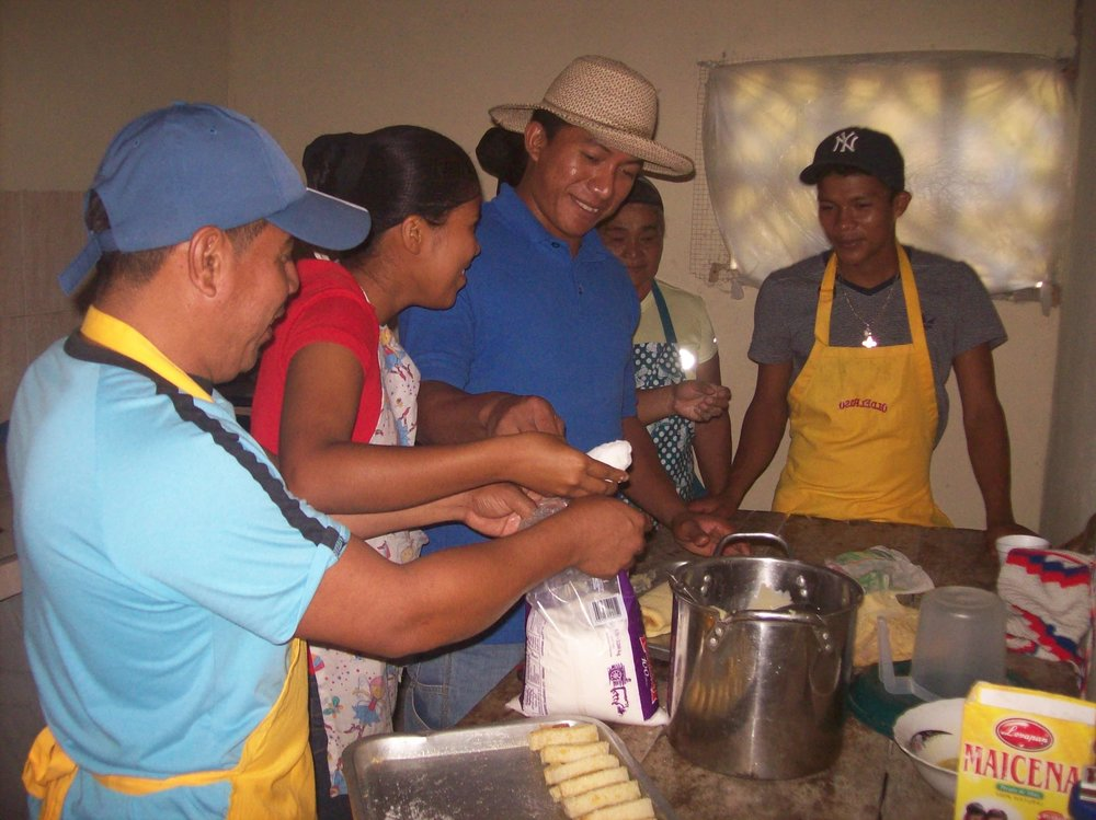 Community members enjoying baking experiments with local fruits and vegetables- photo by LaTaurus Whitley