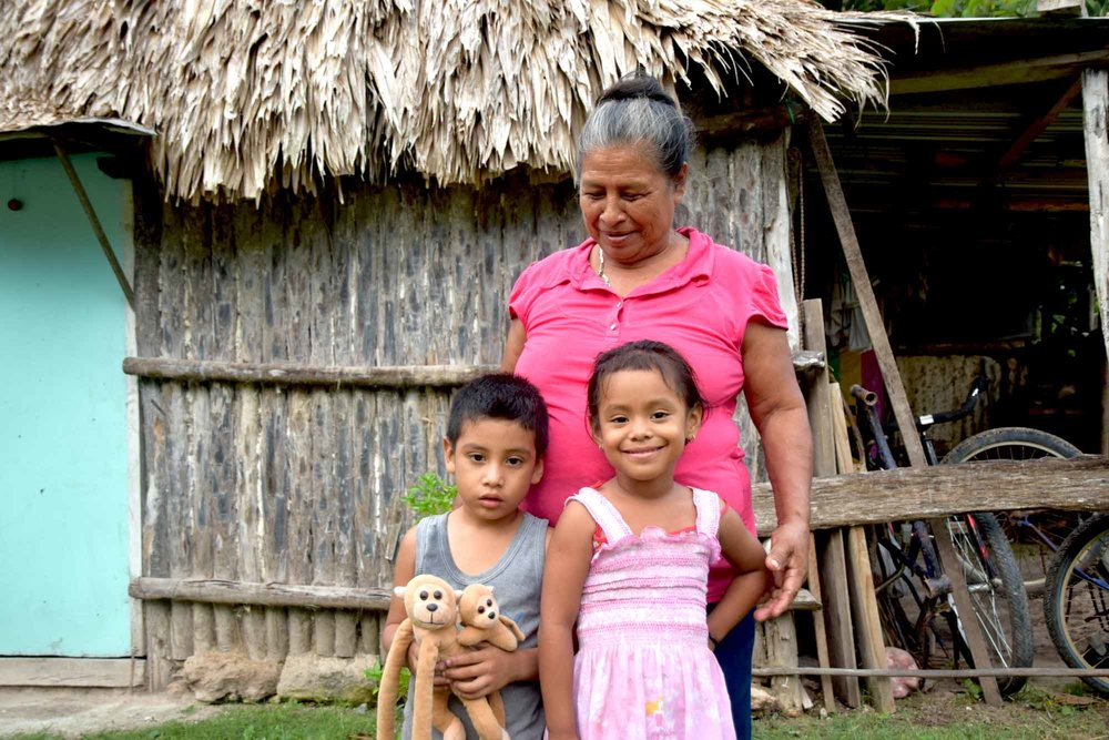 Josefa is investing in a better future for her family, including for her grandchildren Jeymar (left) and Minely (right).
