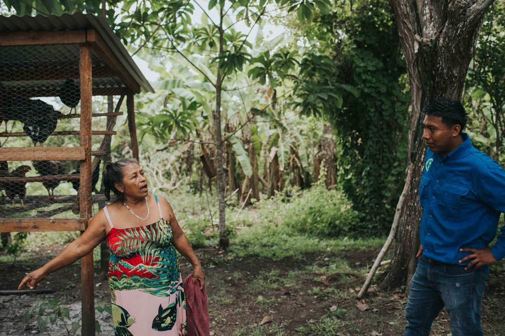 Josefa (L) consults Misael (R), her field trainer, on new projects she plans to carry out. Photo by Salt to Clay Photography