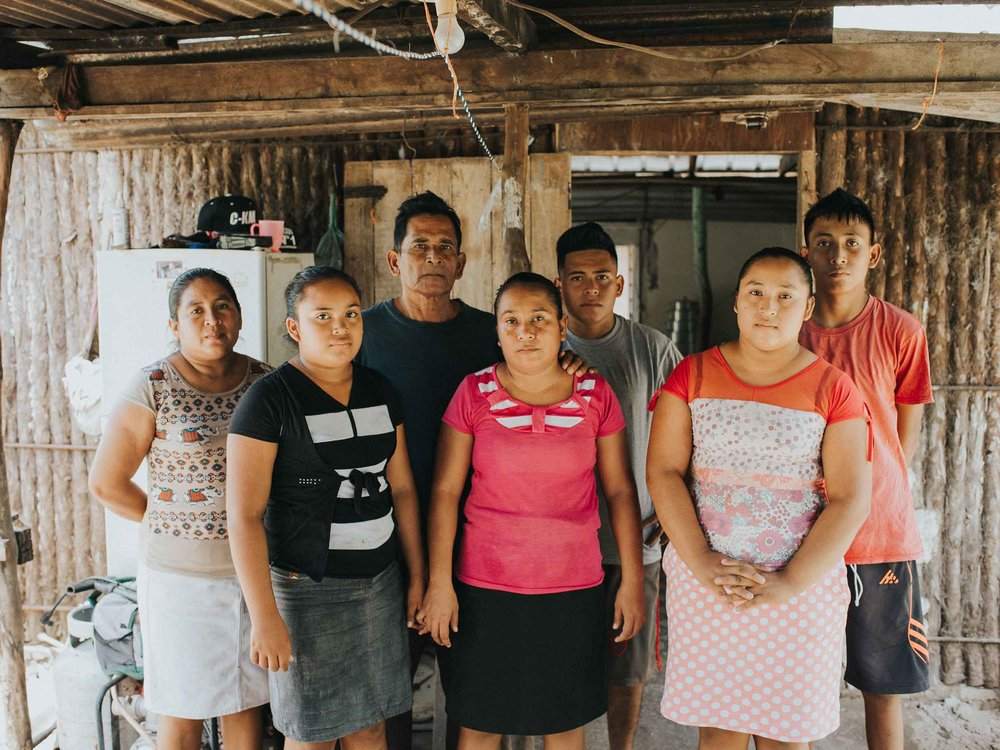 """""""We all want to go to school but our family can't afford it."""" – Erlita Santoya (middle), the eldest of Hernando and Mirla's 11 children Photo by Salt to Clay Photography"""