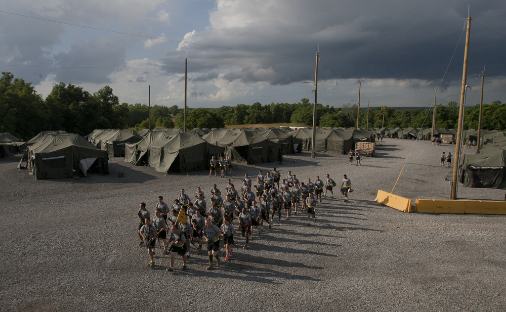 June 28 Cadets march in formation away from their tents. This tent complex was their final home at LDAC. From here they moved into simulated battlefields for the final three days of training.