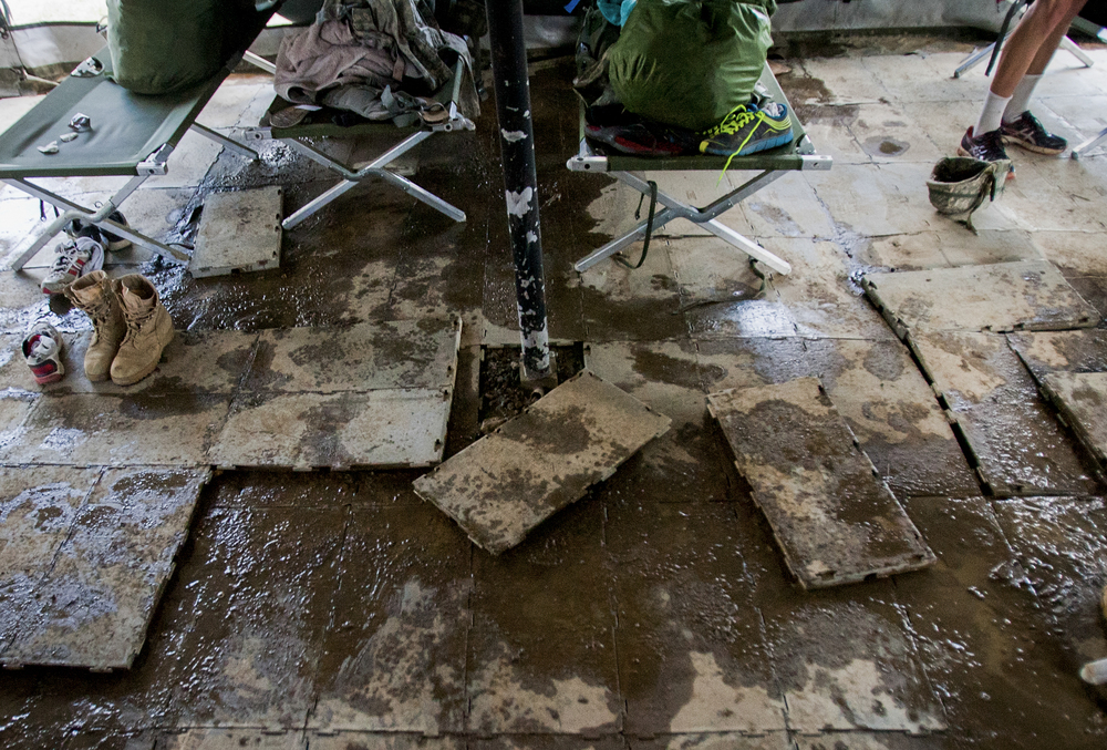 July 9 A tent's tile flooring is washed away after a night of rain. Cadets frequently found themselves sleeping over a muddy pit when the Kentucky weather grew stormy.