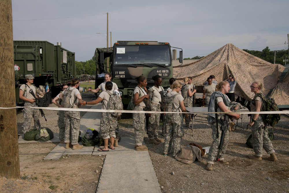 June 27 Female ROTC cadets wait in line to shower after their daily training. Besides training and meals, female and male cadets were consistently separated from each other and slept on opposite sides of the tent complexes.