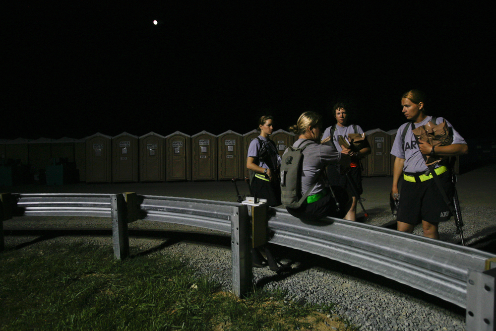 July 10  Battle buddies trade a few last words by the latrines before lights out.
