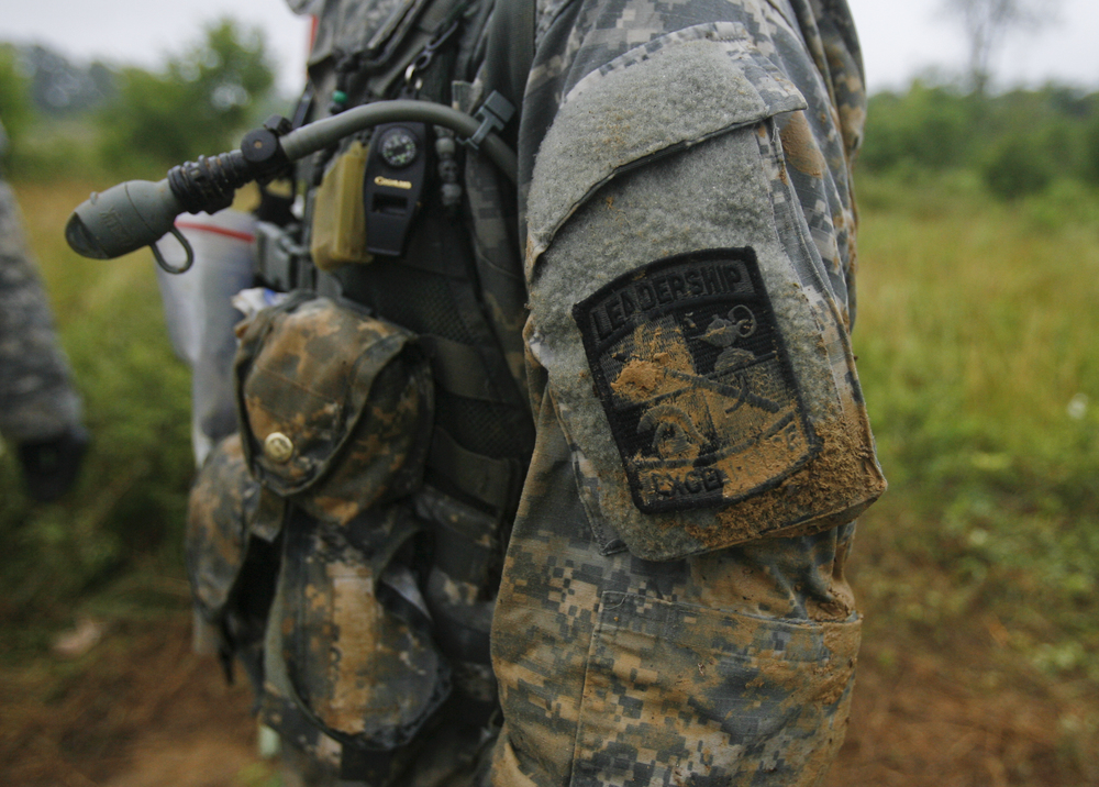 June 25 Every cadet wears an identical uniform. The camouflage featured a built in water-pack and the official ROTC insignia.