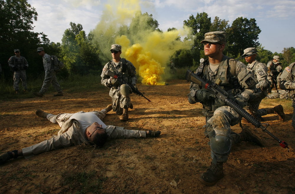 July 10 Cadets prepare to evacuate the area after completing their objective. For this training operation, the cadets had to enter an unknown village, locate and capture a high profile target. Smoke bombs, blank rounds and dramatic acting helped transform the Kentucky landscape into a believable battlefield.