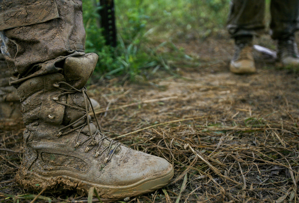 June 25Combat boots are coated in mud after a full day of training.