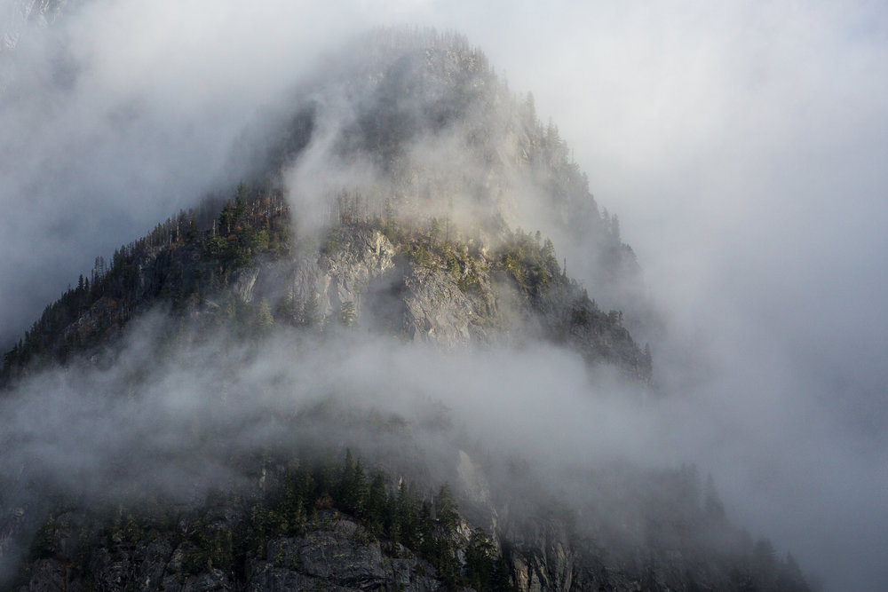 At times the surrounding landscape is veiled in clouds, but then a ray of sunlight will pierce the fog layer and reveal glimpses of the colossal granite walls towering above us. Cloud cover and fog always add an element of mystery to a scene.