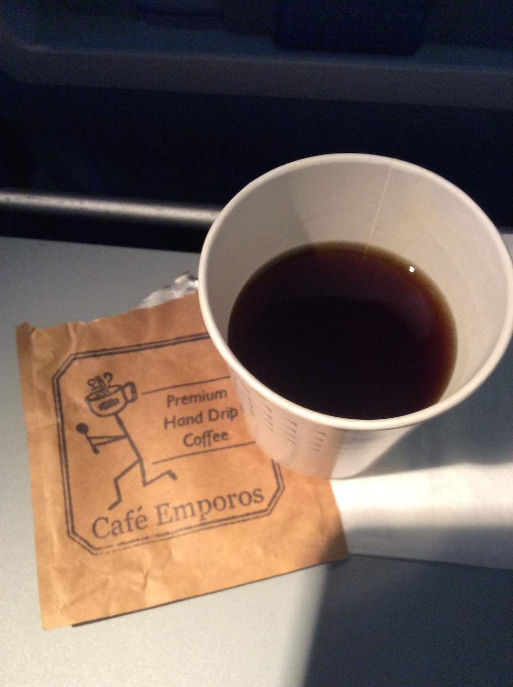 Fresh hand dripped coffee on the airplane courtesy of Cafe Emporos