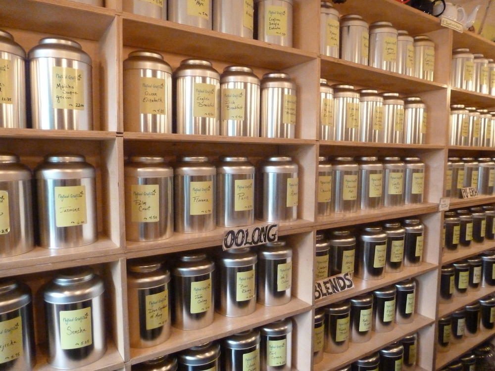 Wall of fresh tea leaves and blends at Physical GraffiTea
