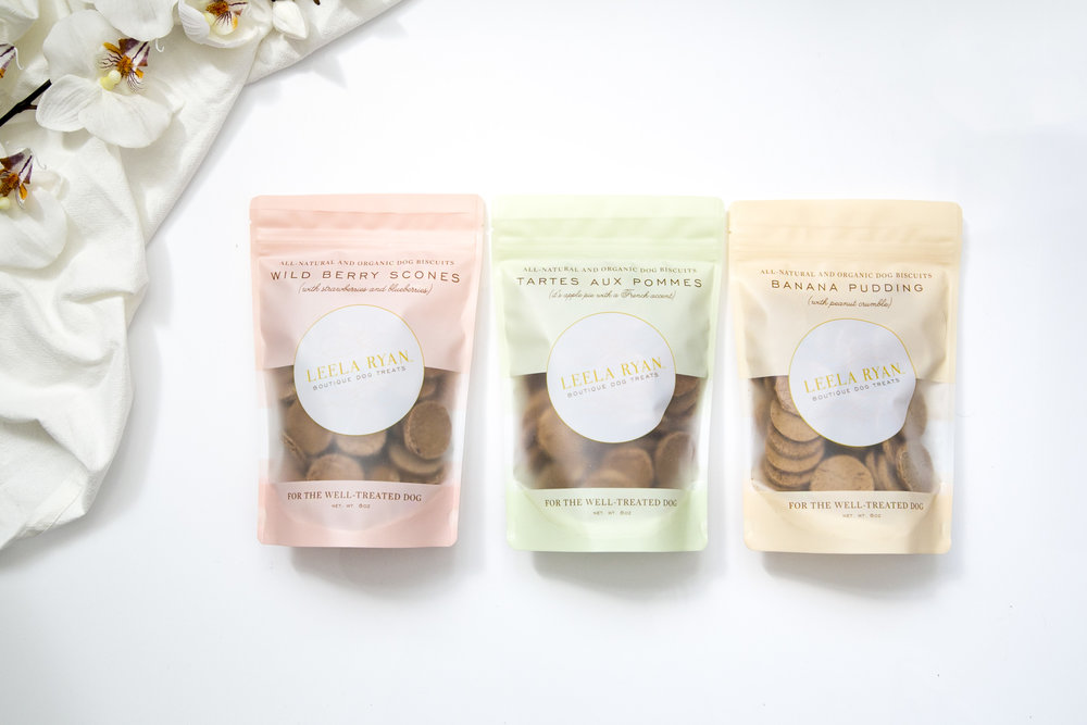 "Leela Ryan Dog Biscuits ""For The Well Treated Dog"" come in three all natural flavors."