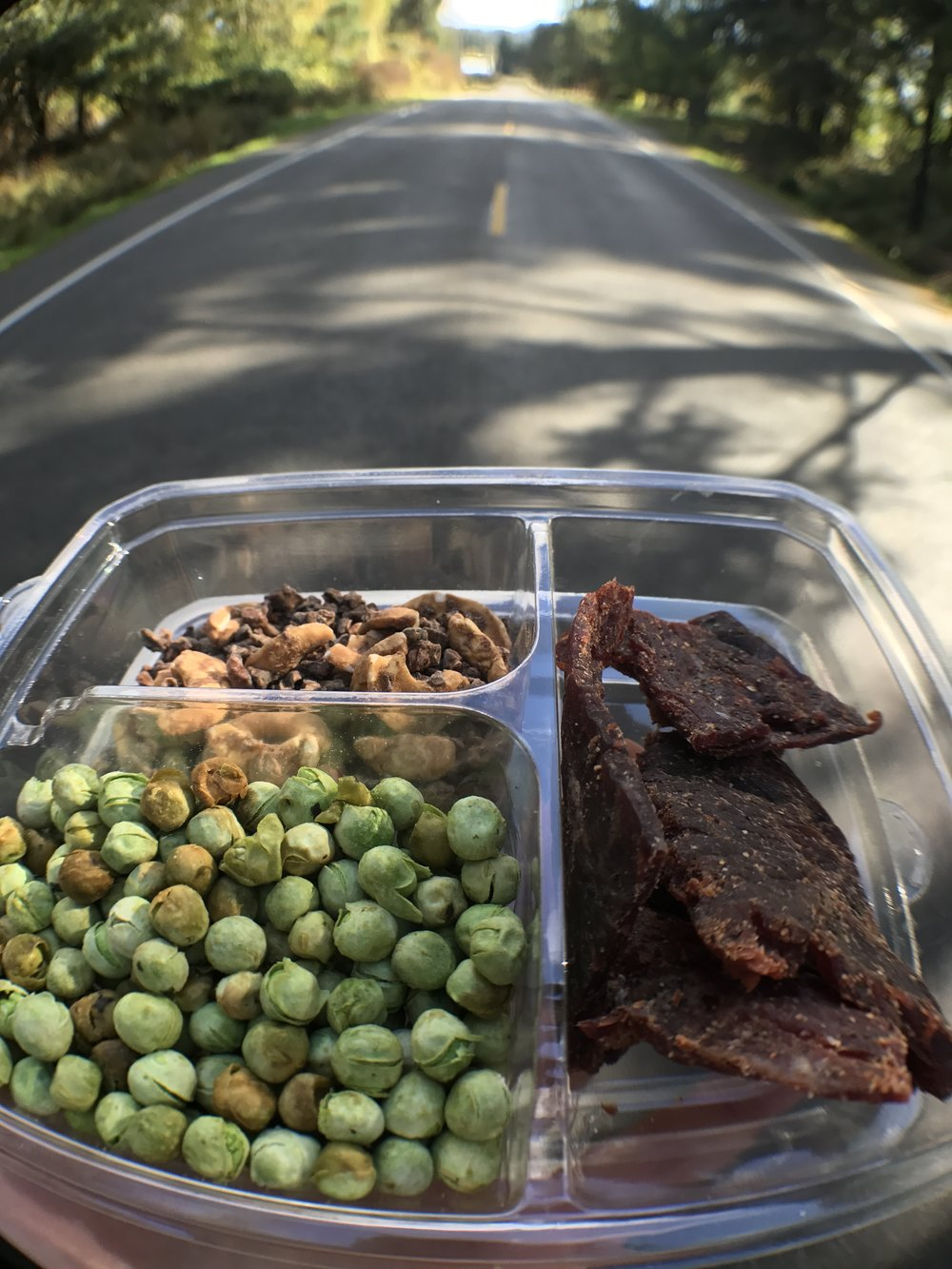 Beef teriyaki with sesame soy peas and seaweed and cashew, cacao clusters.