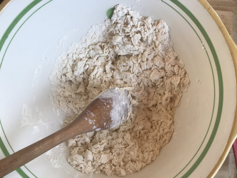 Flour and water ready to be molded into a dough ball.