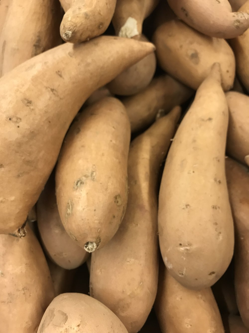 White sweet potato. It's not always easy to know what color the flesh on the inside will be.