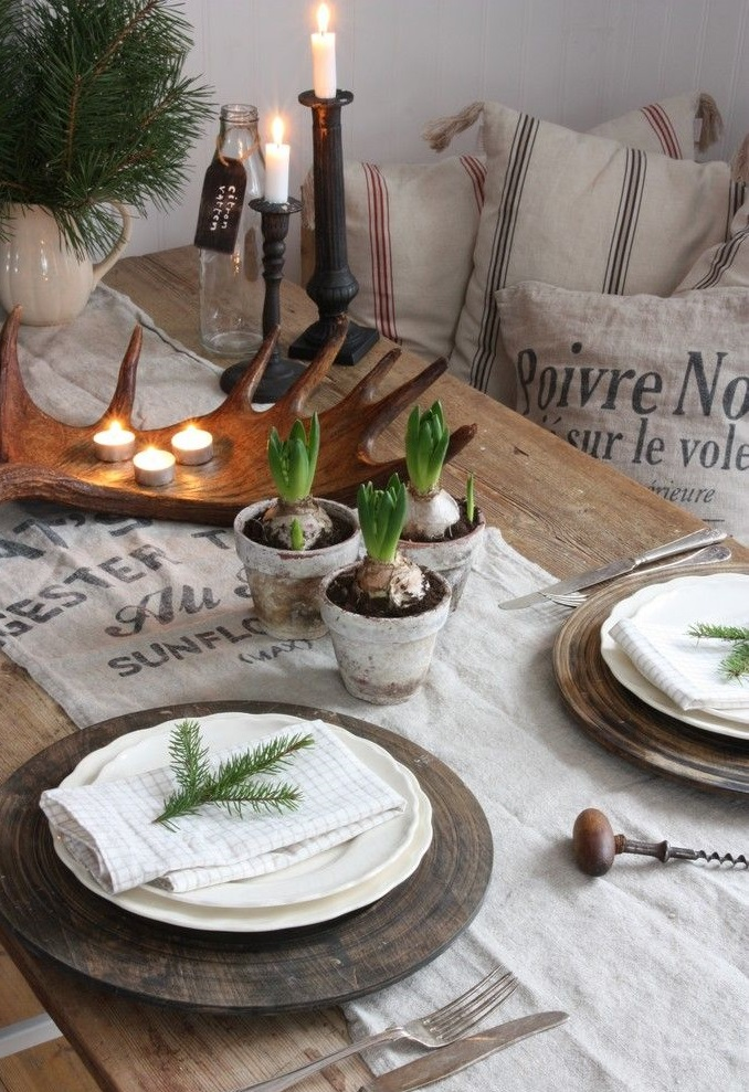 (Paperwhites, neutral linens, wooden chargers, fresh   greenery & glowing candles make a perfect tablescape.)