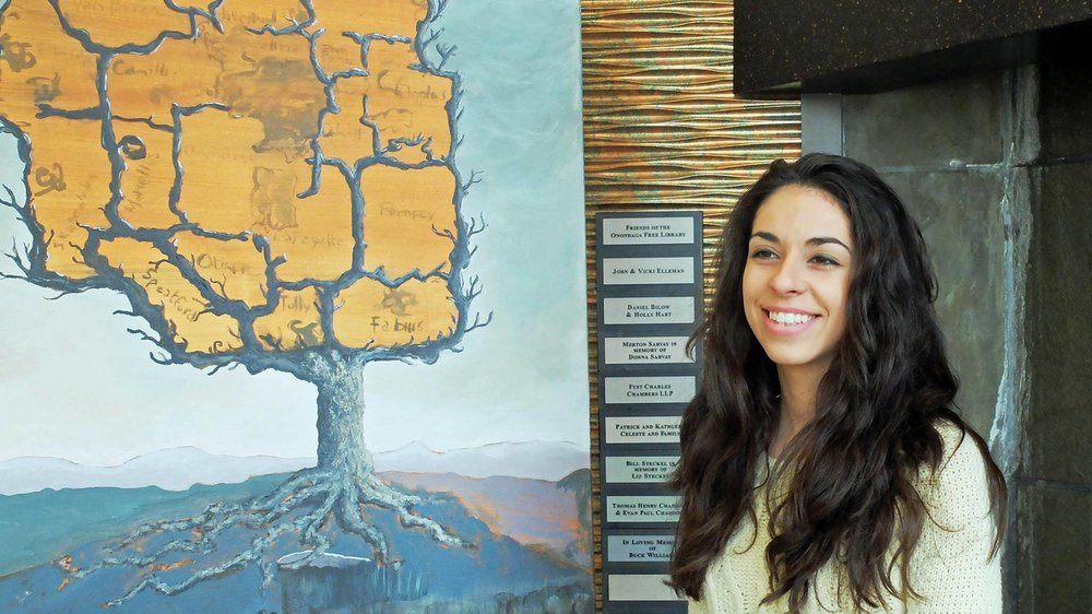 Maria Rizzo in front of the Onondaga Symbolic Tree, a community painting funded by the 2014 Individual Artist Grant from CNY Arts. Photo credits: Ray Trudell.