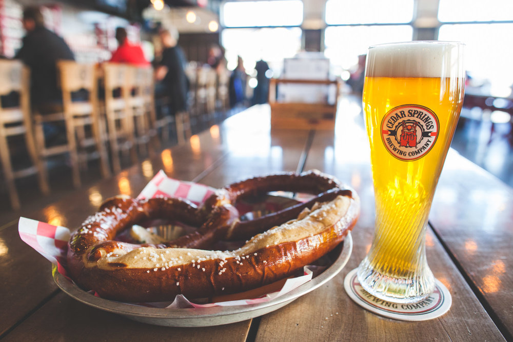 The amazing Bavarian Brauhaus Breze, a beer hall style jumbo pretzel, and a Community Hoppy Hefeweizen.
