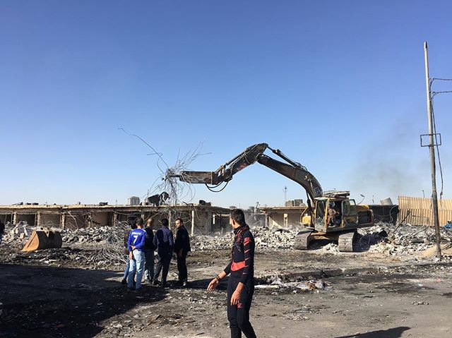 clean up at the treasured langa bazaar, where 1200 shops burned on Thursday